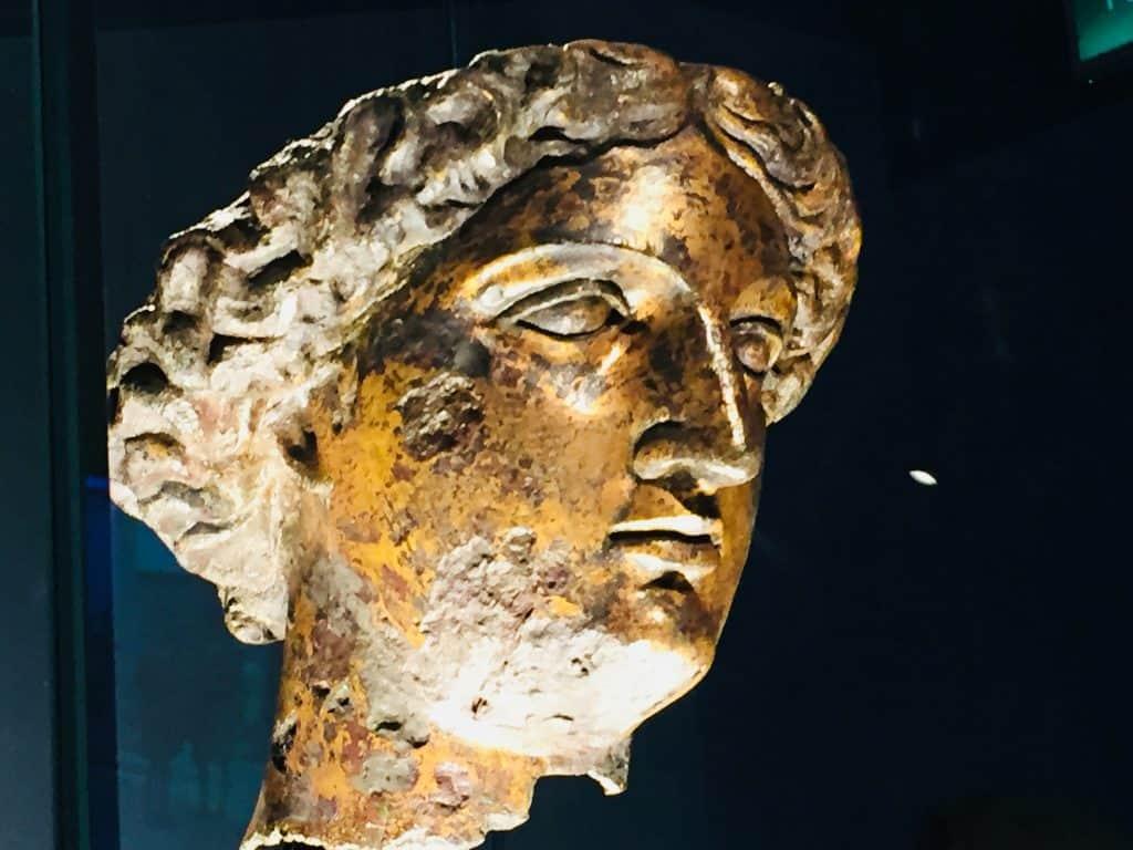 The bronze head of Sulis Minerva in the museum