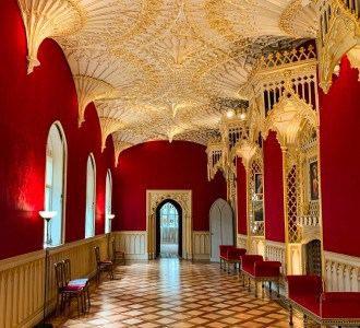 The beautiful Gallery in Strawberry Hill House.  The walls are red and the ceiling is gold.