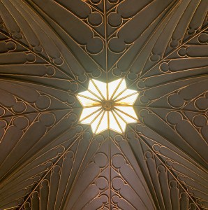 The ceiling in the Tribune room in Strawberry Hill House.  It has gold decoration and a star/ flower shape in the centre