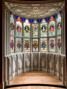 A window in Strawberry Hill House - it has lots of small panes of coloured glass and a bay window