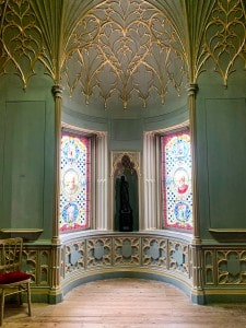 The Tribune in Strawberry Hill House.  The walls are pale green and the ceiling has ornate gold trim on it