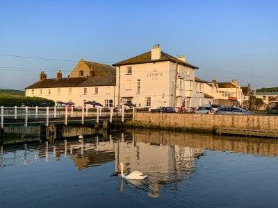 The George pub in West Bay Dorset by the side of the river