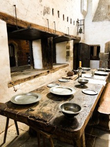 A kitchen table at Hampton Court, laid out for eating