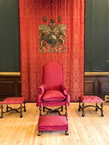 An image of William III's red throne canopy