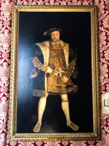 A portrait of Henry VIII that you can see hanging on a day trip to Hampton Court Palace