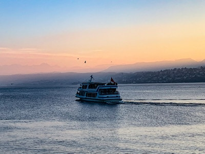 A ferry on Lake Zurich at sunset