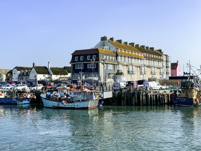 Part of the harbour in West Dorset Dorset with boats on the water