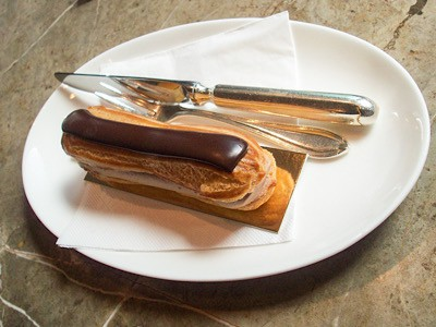 A chocolate eclair on a plate