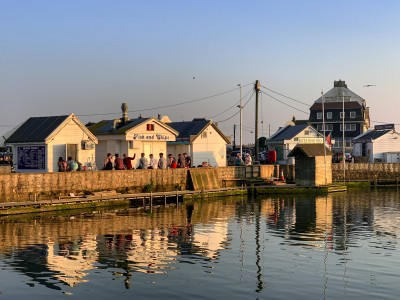 Part of the harbour in West Bay Dorset with its beach huts