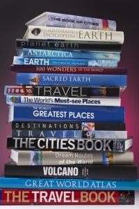 An image of a pile of travel coffee table books