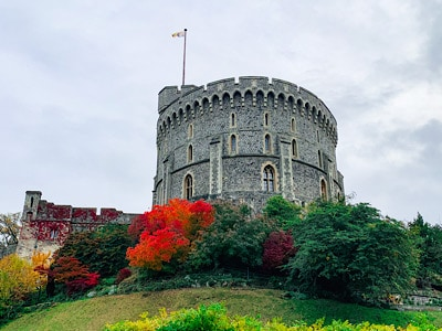 Windsor Castle Round Tower with the flag flying from the top - see this on your day trip to Windsor
