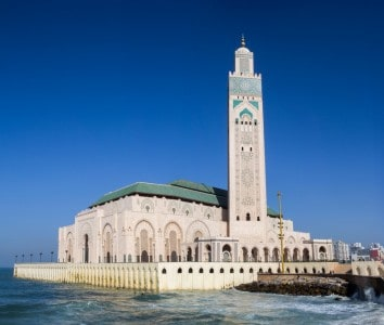 An image of the mosque in Casablanca at the side of the water - you could day trip here during your 3 days in Marrakech