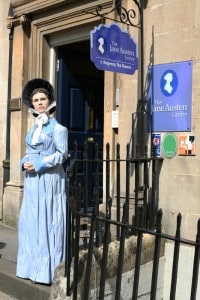 The outside of the Jane Austen Centre in Bath UK with a model of the author outside