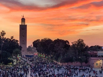 Part of the Jemaa el-Fna at sunset with the Koutoubia mosque in view