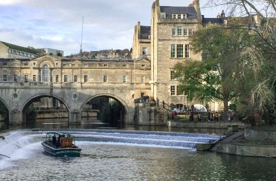 Pulteney Bridge Bath with a boat on the River Avon