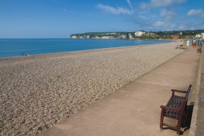 A view of the view sweeping beach in Seaton Devon with the promenade alongside