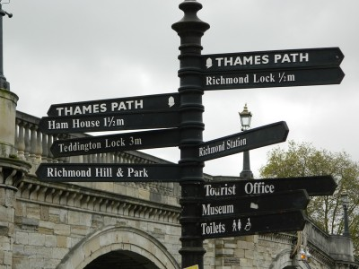 A signpost pointing to different locations on the Thames Path in south west London