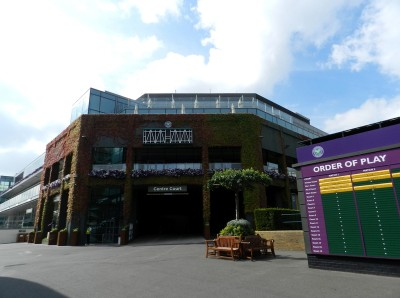 The outside of the Wimbledon Lawn Tennis and Croquet Club with an order of play sign outside.