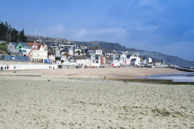 The beach at Lyme Regis with the promenade in the background