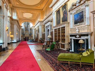 The Long Library that you can visit when visiting Blenheim Palace - it has a long red carpet and an organ at the end