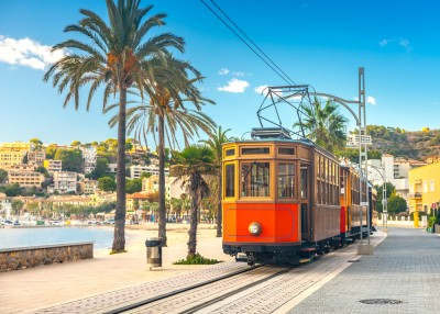 The Tren de Soller in Soller with the sea on the side
