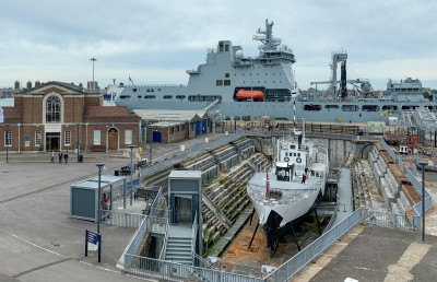 HMS M.33 (foreground ship) in dry dock