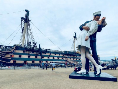 The Embracing Peace statue in front of HMS Victory - one of the Portsmouth attractions you can see in the dockyard