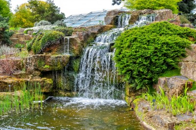 A rock garden at Kew with a waterfall