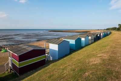 Beach huts along the beach in Whitstable