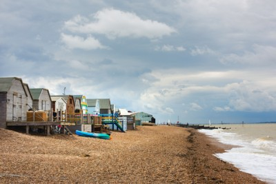 Whitstable beach with some beach huts along the side
